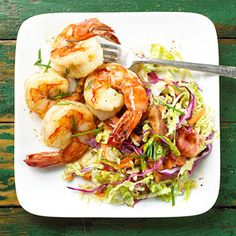 Shrimp with Warm Coleslaw This quick and easy meal adds coleslaw, bacon and chives to delicious shrimp.
