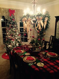 I prefer more than one tree in the house at the holidays. This one welcomes neighbors through the beveled glass window in the formal dining room