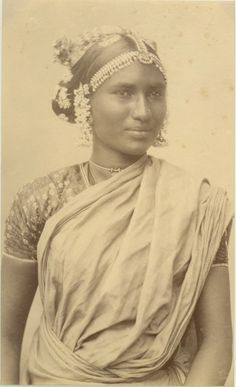 Portrait of an Indian Woman. Her hair decorated with flowers and ornaments, 1880