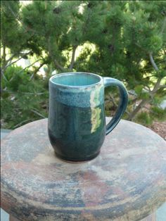 Stoneware mug with layered glazes by Shelley Duncan