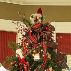 Place a Santa ornament at the top of the tree to guard the presents. Pair it with plaid ribbon for a jolly look.