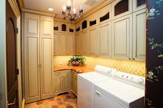 Projects | Village Cupboards Upstairs laundry room with faux-finished cabinets