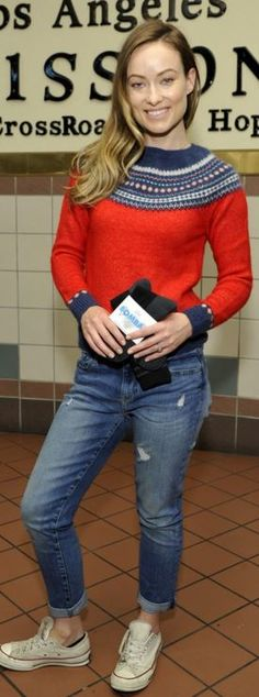 Who made Olivia Wilde's red print sweater, blue jeans, and white sneakers?