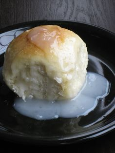 one of my favorite desserts (thank you to all the Polynesians out there who made this food possible) basically sweet dough rolls, baked in a sweet oconut sauce, mmmmmm i can eat a good eight of these without breaking a sweat.