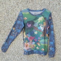 0df74bf93b Disney Alice in Wonderland long sleeve sweater Lightweight but warm Size S   vintage  thrifted. Depop