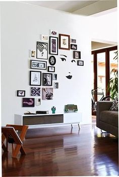 An unexpected layout! Recreating this gallery wall is easy and damage-free to your walls when using Command™ Picture Hanging Strips! Click the link to learn more!