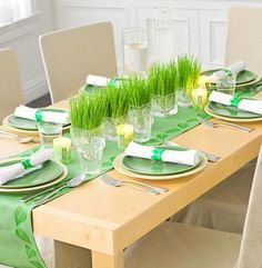 Line the center of your table with small containers of wheatgrass for an unusual centerpiece. More spring centerpieces: http://www.midwestliving.com/homes/entertaining/spring-centerpieces/