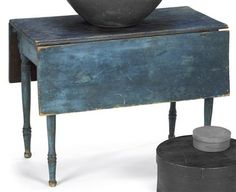 Late Federal blue painted drop-leaf table circa 1815 Rectangular top with conforming leaves on turned legs ending in shaped feet. H: 29 1/4 in. W: 20 1/2 in. D: 39 in. Leaves: 13 in.