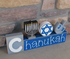 We love this...CHANUKAH BLOCKS with Menora, Jewish Star, and Driedall for desk, shelf, mantle, Hanukkah, December, and home decor. $24.95, via Etsy.