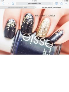 Navy blue nails with gold glitter