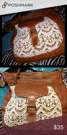 Brown leather purse A medium sized brown leather purse with lace-like covering on the front. One pocket inside and and two on the outside. Very roomy. Discontinued at original seller Mossimo Supply Co. Bags Shoulder Bags
