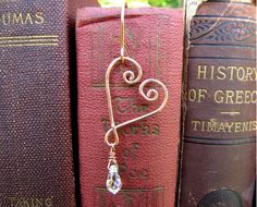 Open Heart Handmade Bookmark - Valentine Bookmark with Swarovski Crystal and Copper, Hand Forged and Wire Wrapped. $12.00, via Etsy.