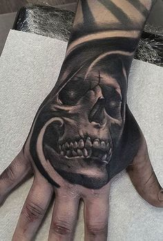 Hand tattoos for men are trendy right now. Getting a hand tattoo is a huge commitment. In this article we have collection trendy hand tattoos for men. Skull Rose Tattoos, Skull Hand Tattoo, Hand Tats, Skull Tattoo Design, Body Art Tattoos, Ear Tattoos, Unique Hand Tattoos, Hand Tattoos For Guys, Hand Tattoos For Men