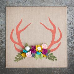 This fabulous and trendy painted antler decor paired with felt flowers is just what you need! This will go great in your new babies room, in