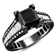 18k Black Gold Black Princess Cut Diamond Engagement Ring - Here is a very large, stunning & certified 3.25 carat Black Princess Cut Diamond Engagement Ring set in a lovely 18k Black Gold. This wide ring features a AAA quality 1.50 carat Black Princess Cut diamond is set atop of the ring. It also comes with beautiful 1.75 carat VS1-VS2 clarity & E color princess cut & round diamonds that surround the solitaire. The ring measures 7.5mm wide & the diamonds are 100% natural…