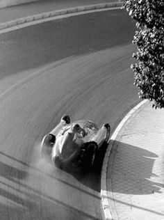 Louis Klemantanski's beautiful shot of Juan Manuel Fangio drifting his Lancia D50 around Monaco.