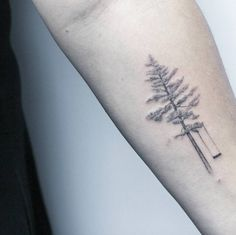 Elegant tree swing tattoo by Lindsay April
