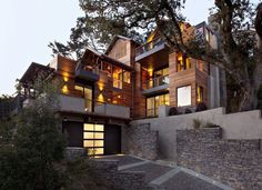 Nestled in the hills of Mill Valley, California, the Hillside House is a LEED Plantinum certified home with high sustainability designed by SB Architects. Built on a steep hillside site, the modern red cedar house has a vertical design with multi-level living spaces that reduces its footprint. Views of the bay and the San Francisco skyline can be enjoyed from the numerous balconies and outdoor terraces.