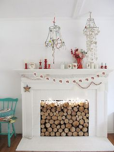 Chopped wood logs stored in fireplace, especially if fireplace is out of order