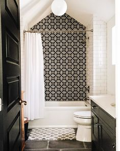 Black and white space- the focal point was the tile wall. I then looked toward the other bold furniture the door and the cabinet.