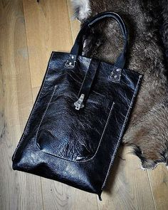 Black leather unisex bag by @burtsevbags