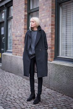 Ellen Claesson is wearing a grey coat from H&M, matching sweater from Zara, skinny jeans and boots both from Acne