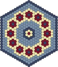 "Hexagon Table Topper; a second color topper in other colors is shown; 1.25"" hexie, 47.5"" finished"