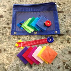 Button snake busy bag- looks like a button on a ribbon and then felt pieces with a slit.