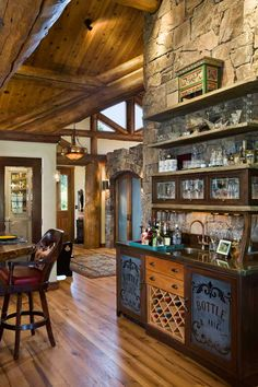A wet bar was built into the back of the floor-to-ceiling fireplace. Featuring…