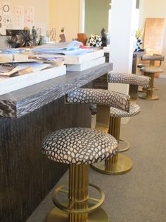 Cool brass and animal like skin stools Kelly Wearstler studio