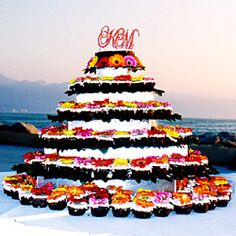 This couple opted for a unique tower of cupcakes topped with colorful gerbera daisies.