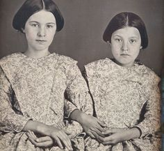 Daguerreotype of two sisters seated arm-in-arm and wearing dresses cut from identical cloth. Anonymous American, 1840s