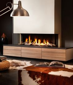 Fireplaces Trends - Dru Gas Fireplace PowerVent in a Modern Design Living Room with the Cutest Cow Hocker!