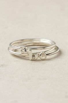 i don't think it's a coincidence that this is my monogram..... Wee Initial Ring - Anthropologie.com