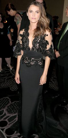 Keri Russell graced the 31st Annual Television Critics Association Awards in a plunging kimono-inspired black Zuhair Murad evening gown with a sheer lace beaded bodice and silk crepe skirt.