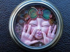 Pucker Up Steampunk Pocket Watch Myxie by MysticReflections, hand sculpted polymer clay Myxie inside a hollow pocket watch casing.