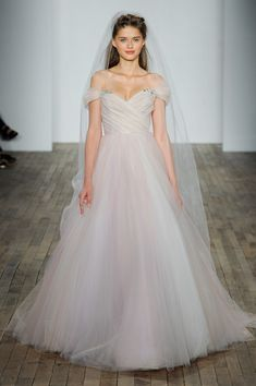 """""""Milo,"""" Hydrangea draped tulle ball gown, sculpted sweetheart bodice and off-the-shoulder embellished cap sleeve, [Blush by Hayley Paige](https://www.brides.com/photo/wedding-dresses/designer/blush-by-hayley-paige?)"""