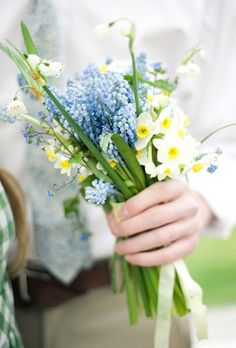 Rustic Blue and Yellow Bouquet with Daffodills. DaffodilWhat do marriage and this shapely spring flower have in common? Both represent new beginnings, which is tailor-made for a bride and groom's big day.Featured In: Rustic Blue and Yellow Bouquet with DaffodillsPhoto:  Lisa Warninger