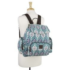 The Bella Taylor Lanai Rucksack is a perfect combo of functionality and fashion-forward style. Pack gym clothes, books, a laptop (can hold a 13' MacBook) or snacks in a comfortable bag for an active agenda. Lanai showcases a fun medallion print for a fresh take on trendy. Featuring indigo, marshmallow creme, turquoise. Enjoy the comfort of cushioned coffee brown leather with adjustable cotton straps.  Single Fabric; Machine stitched; Enzyme-washed canvas fabric printed in turquoise, indigo…