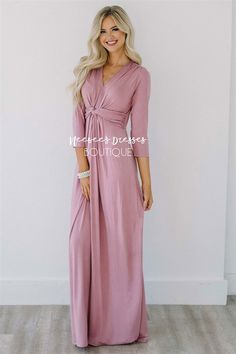 How beautiful is this new full length dress! We are in love with the flattering twist front detailing. Dusty pink dress features 3/4 length sleeves, v neck front and long flowy maxi skirt.