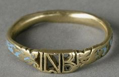 "Ring of the Empress Josephine ~ Gold ring studded with blue and cut to form the center the letters ""NB"" (Napoleon Bonaparte), with both sides of foliage. The outer periphery of the ring carries on blue enamel background the inscription: ""Love sincere."""