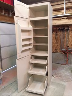 I love the pull-out drawers in this little pantry for a tiny home. Could work in a kitchen or laundry room. Sweet.