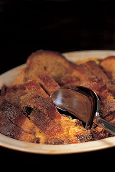This is the wholesome, comforting version of a trad English (white) bread and butter pudding that my maternal grandmother always made.  Use apricot jam or regular orange marmalade if ginger's not your thing.