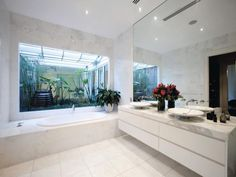 Marble tiles and vanity,white vanity with shadow line handles.