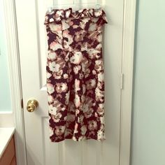 Floral strapless dress Absolutely stunning. Built in padded cups, partial open back, back zip and snaps, tulip skirt, adorable ruffle. Worn once. From a boutique. The background color is a really dark navy, almost blackish. Dresses Strapless