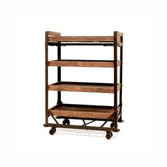 Industrial Factory Cart Shelf       Factory cart. Made of wood and metal use this factory cart for that industrial look in your home. Great for storage in the office, den or kitchen. The ultimate in industrial style. Featured in County Living Magazine, April 2010. (32w x 15d x 44h). Assembly required.    $650  As open storage unit ( against wall )