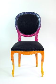 This is a fun, bright and unique occasional chair that was inspired by the colouring in sunsets, combined with elements of fashion and trends. It has gradiented colours in purple, pink, orange and yellow paint and hand finnished with a layer of black and white marbling then upholstered in a black leopard print fabric and black studded trimming.   A statement piece that has a fun and whimsical side that would also look striking in the home.