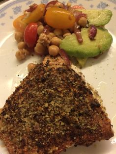 Melon seed crusted snapper fillet with chick pea, avocado and tomato salad served with Spanish onions and garlic cooked in sherry vinegar and olive oil