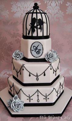 Contemporary Parisienne-styled cameo-pink and black wedding cake from designer Emma Procopiou, proprietor of We Want Cake in Cheshunt, Hertfordshire, England.The silver-gray sugar roses beautifully accent the colors and are a perfect touch. Gorgeous Cakes, Pretty Cakes, Cute Cakes, Amazing Cakes, Yummy Cakes, Whimsical Wedding Cakes, Black Wedding Cakes, Wedding Cake Designs, Bird Cage Cake