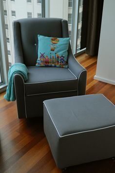 Modern Glider: Little Castle Glider & Ottoman from @Anne BABY. We think the gray with white piping looks so sharp!